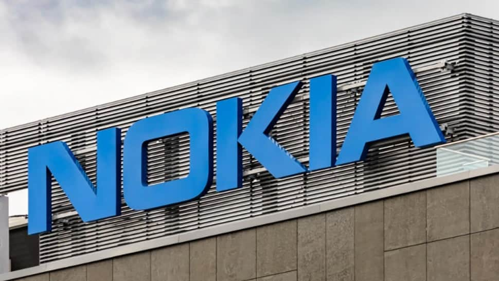 A sign on the top of a building with the letters Nokia.