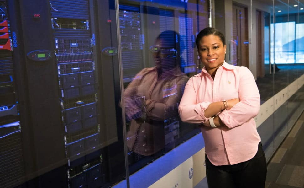 Image of a woman leaning at a server stack protective window.