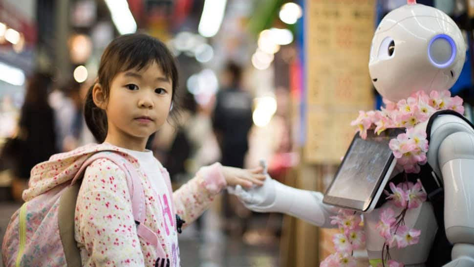 Little girl touching the hand of Ai Advanced Research Robot.